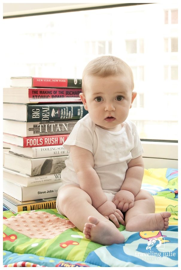 baby with stack of books