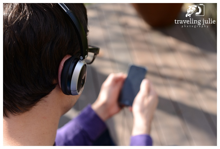 man listening to podcast on smartphone